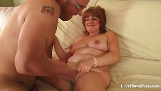Red haired mature with big tits is crippling high heels while deviousness on her husband
