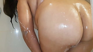 Bbw with splendid knockers taking a shower