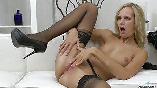 Seductive blonde cougar Jenny Smart moans while masturbating
