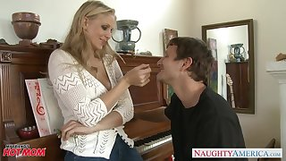 Downcast busty MILF Julia Ann provides their way stud with a good blowjob