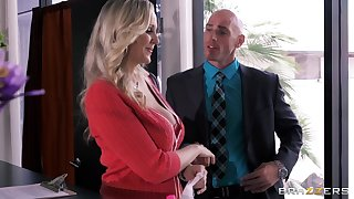 Busty secretary Julia Ann drops exposed to her knees to please her boss